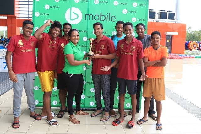 Hillview College Spartans presented with their trophy from Anjanie Ramesar-Soom, Manager, Corporate and Community Affairs, TSTT as they take home the Boys Combined Team division title at the bmobile National Secondary Schools' Swim Meet.