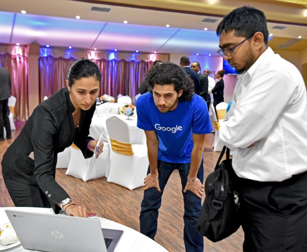 Dylan Katz (centre), Solutions Consultant, Google, analyses the website of a client of RBC Royal Bank during the bank's e-commerce workshop.