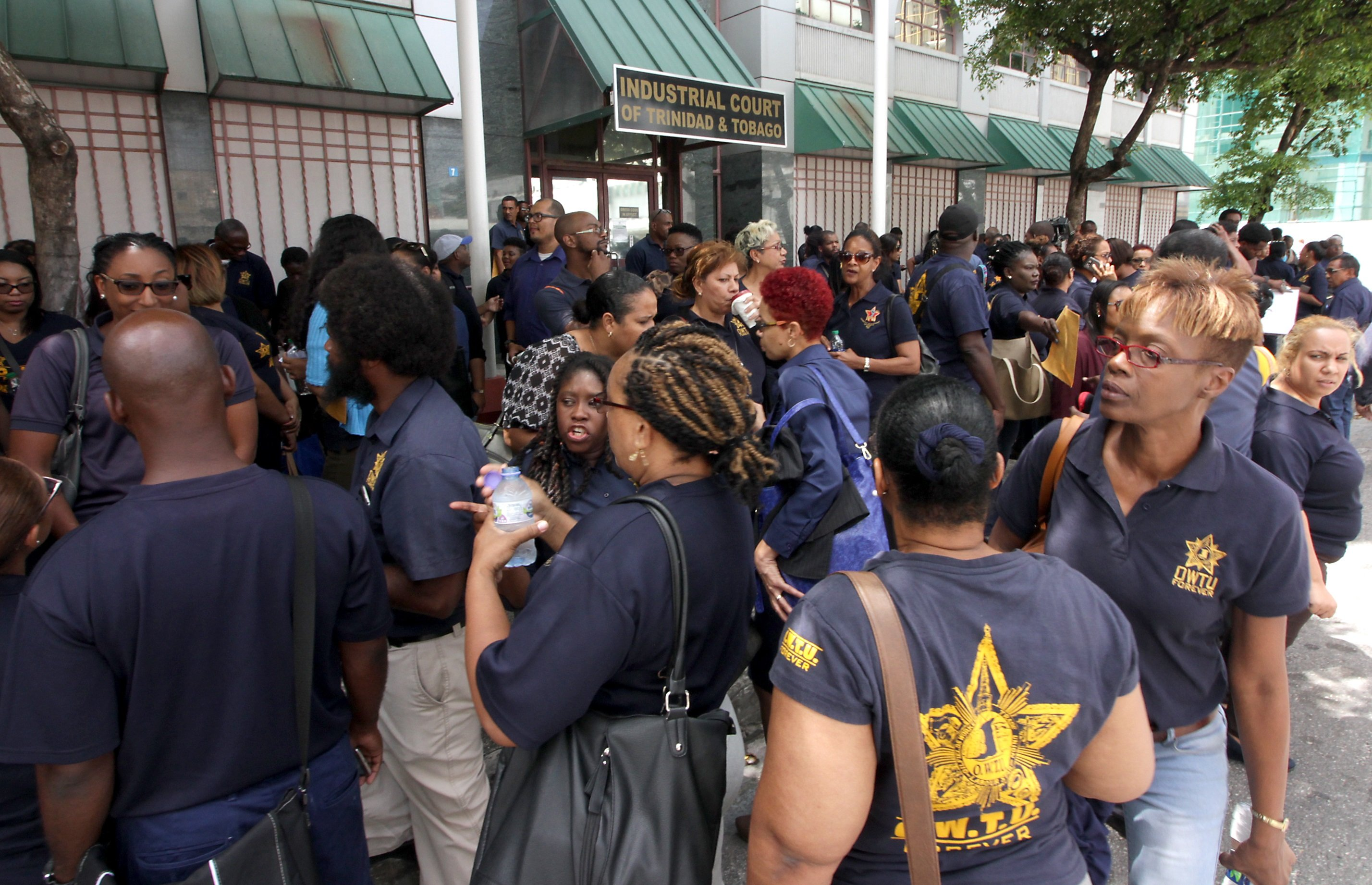 UTT workers outside the Industrial Court in Port of Spain on Monday. PHOTO BY ROGER JACOB