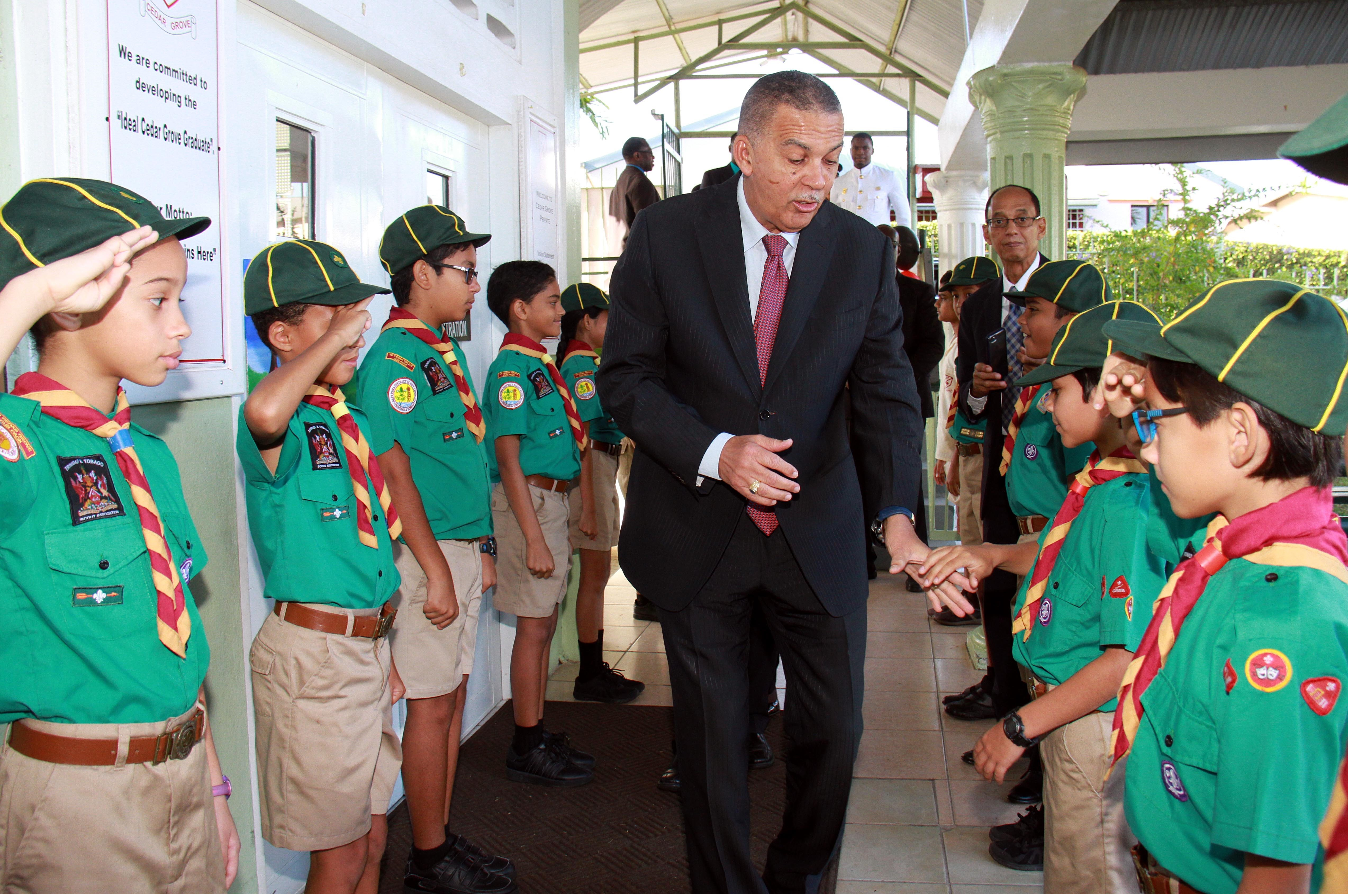 Your Excellency: Cedar Grove Primary School scouts salute President Anthony Carmona during  a visit to the school in Palmiste on Thursday. Carmona had a outreach to children and young  people during his presidency. PHOTO BY ANIL RAMPERSAD.