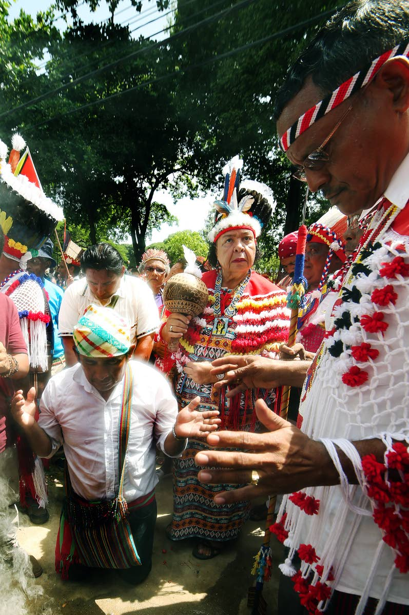The Santa Rosa First Peoples perform an invocation outside the Red House, Port of Spain on October 12, 2017.