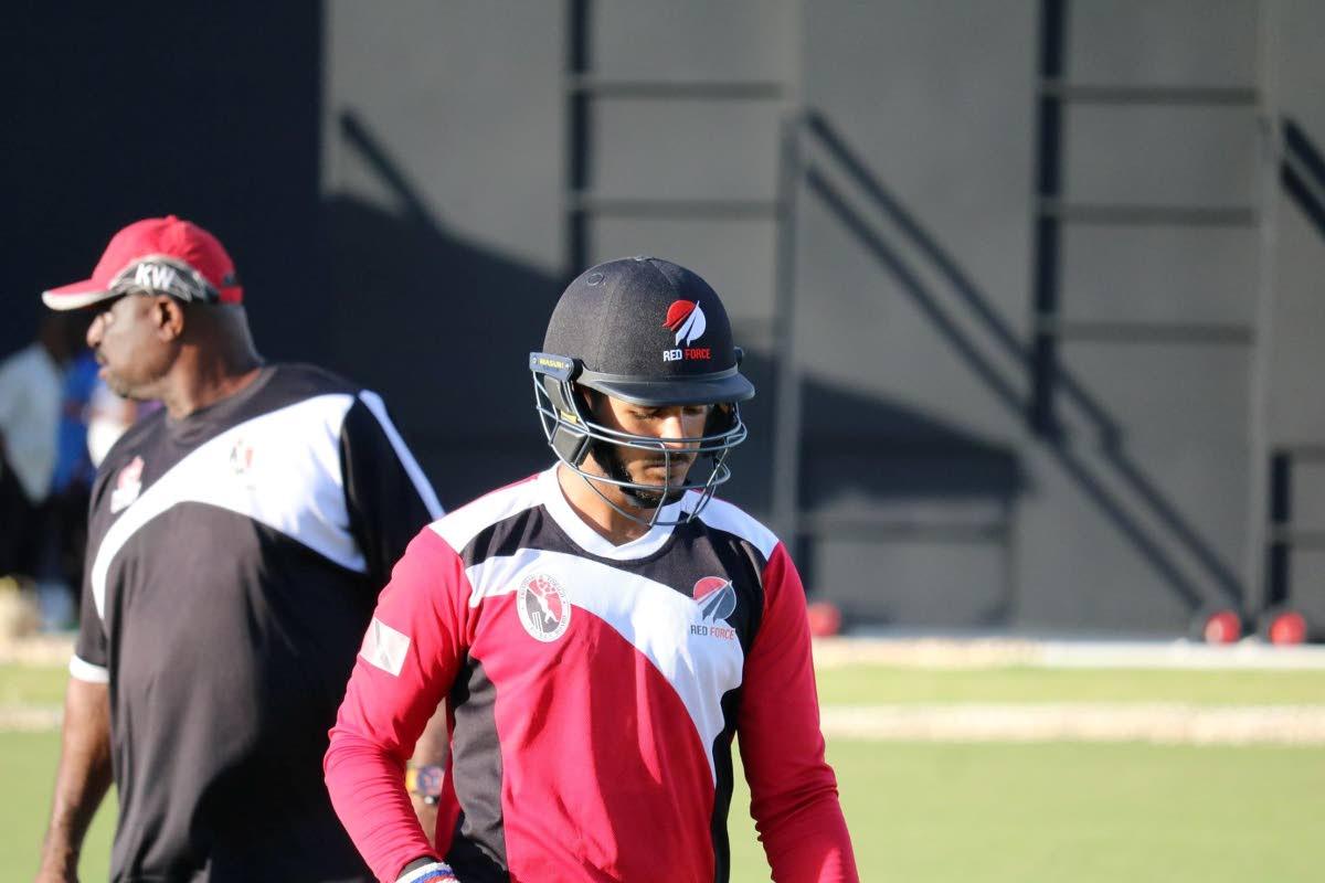 FLASHBACK: Red Force batsman Amir Jangoo, right, in a training session last year at the Brian Lara  Academy in Tarouba as coach kelvin Williams, left, keeps an eye on proceedings.
