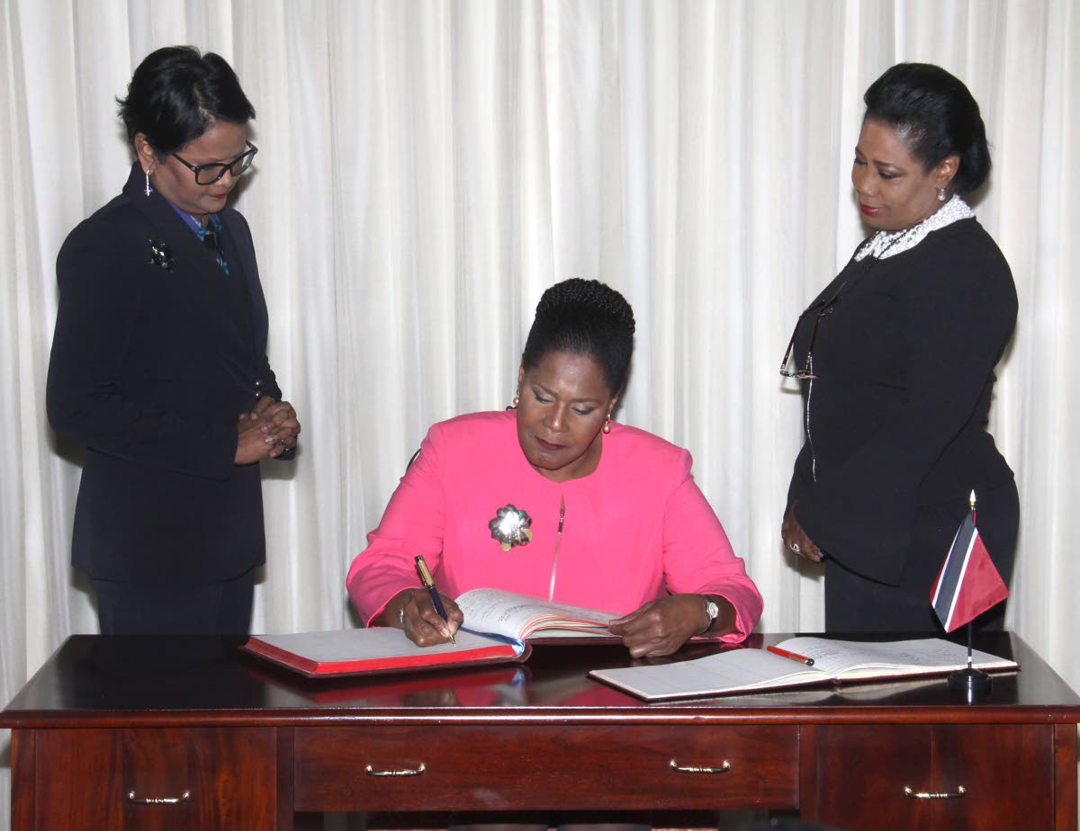 Signing upon receiving her instruments of election confirming her as the Electoral College's unanimous choice as TT's next President.