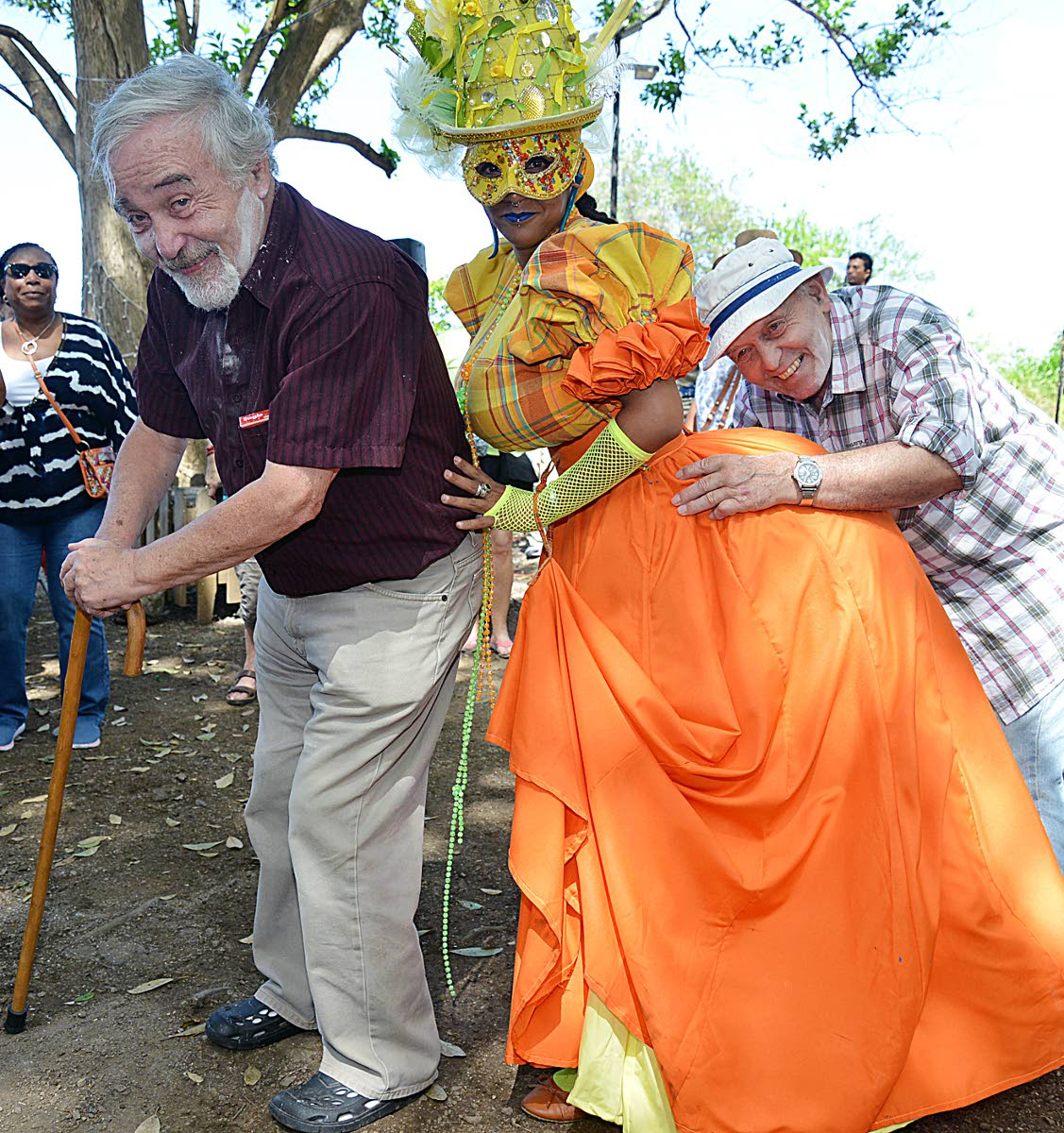 Dame Lorraine wine: Tourist (L) Dr Martin Biggs and Graham Biggs   visiting Nelson Island heritage site were delighted as traditional carnival artist performed before them on the Island as part of the Nelson Island carnival tour PHOTO BY AZLAN MOHAMMED