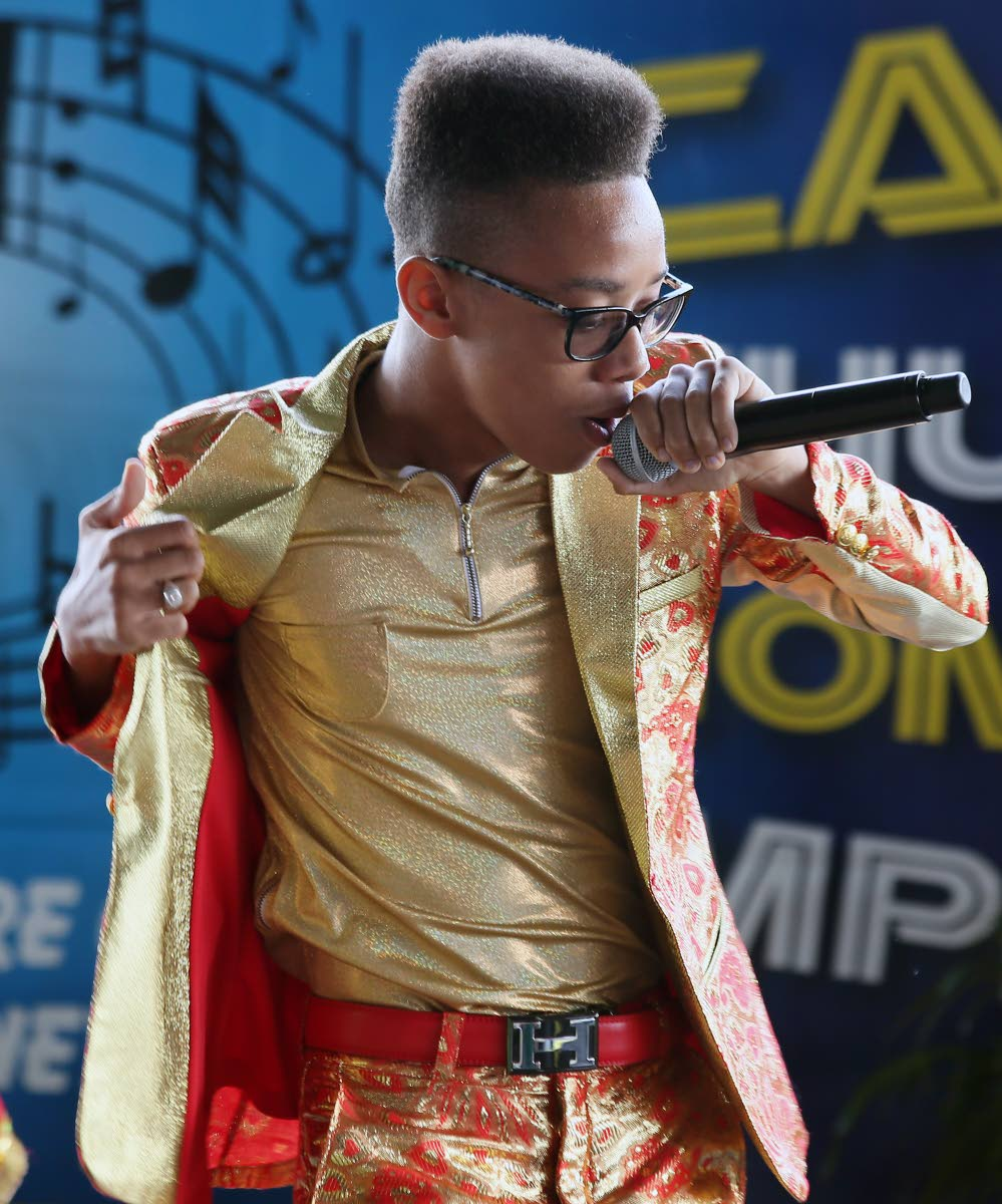 MOVING ON: Five-time Schools National Carnival Intellectual Chutney Soca Monarch champ Aaron Duncan during his winning performance yesterday at the Queen's Park Savannah.
