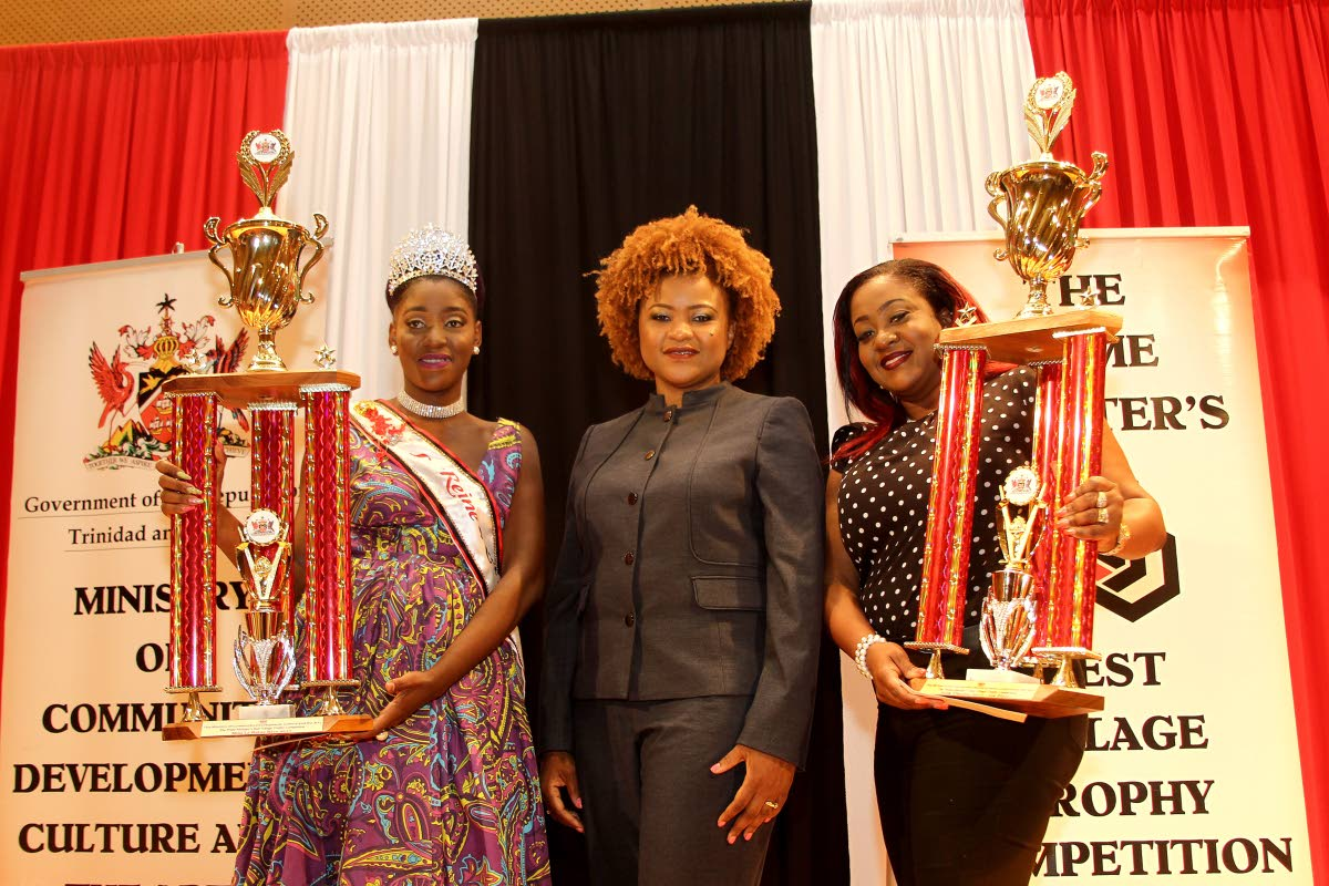 BEST WOMEN: Culture Minister Dr Nyan Gadsby-Dolly is flanked by Miss La Reine Rive winner Rayshawn Pierre (left) from the North West Laventille Cultural Movement and winner of the Folk Theatre, Lieselle John-Clarke at yesterday's Prime Minister's Best Village prize distribution and launch of 2018 competition.