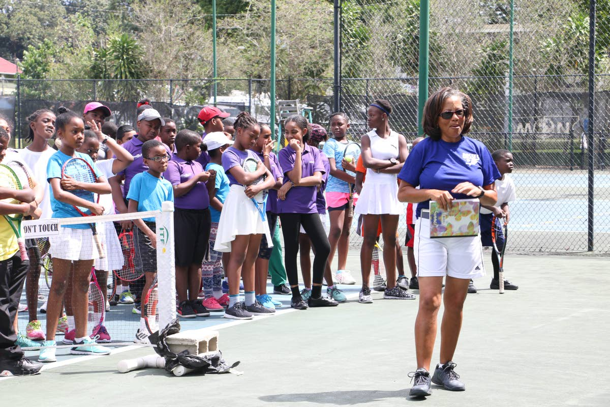 Rhonda Mohammed, right, head coach of Bosses Tennis Academy, addresses participants at Sunday's competition at UWI Courts, St Augustine.
