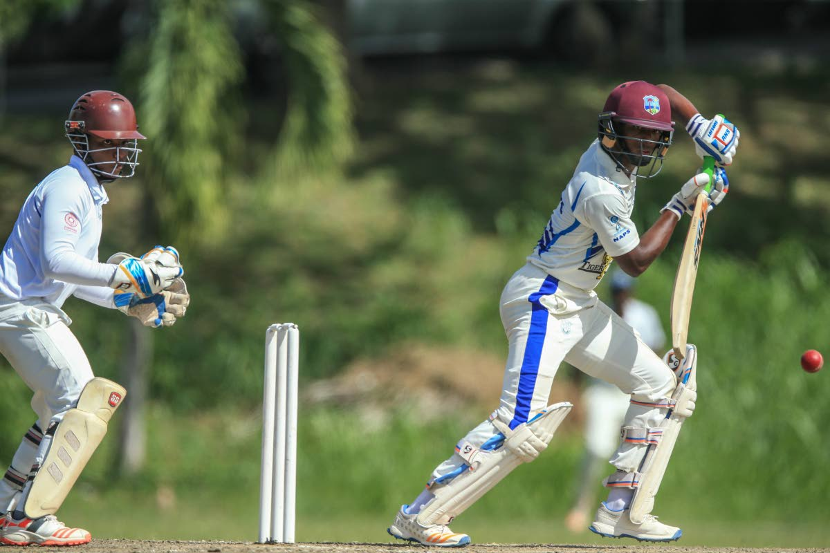 Naparima's Cephas Cooper plays a shot against Fatima in a Powergen Secondary Schools Cricket League match at Lewis Street, San Fernando, yesterday.