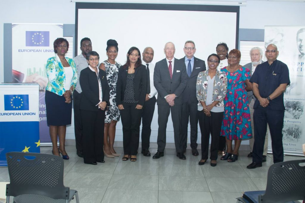 EU Delegation to TT's Grant Funding Ceremony on February 21, 2018: Ambassador Arend Biesebroek, Head of the European Union Delegation to TT (centre, front), Ambassador Jules Bijl, Kingdom of the Netherlands (centre, back), Monica Paul McLean, Programme Manager, EU Delegation (left) and Permanent Secretary  of the Ministry of Planning and Development, Joanne Deoraj (second from left) pose with members of the eight civil society organisations that were awarded grant funding totalling TT$7 million  to implement two projects in the areas of Business/Economy and Environment/Climate  Change. PHOTO COURTESY THE EU DELEGATION.
