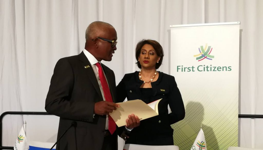 First Citizens Group Chairman Anthony Smart and First Citizens Group CEO Karen Darbasie in discussion ahead of 21st Annual Meeting of shareholders of First Citizens Bank Ltd, Hilton Trinidad, on February 23, 2018. PHOTO BY SASHA HARRINANAN