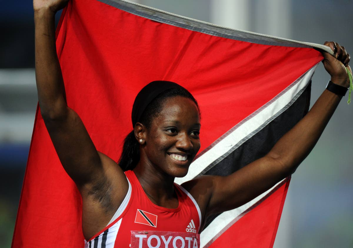 Trinidad and Tobago's Kelly-Ann Baptiste celebrates after the women's 100 metres final at the International Association of Athletics Federations (IAAF) World Championships in Daegu on August 29, 2011.