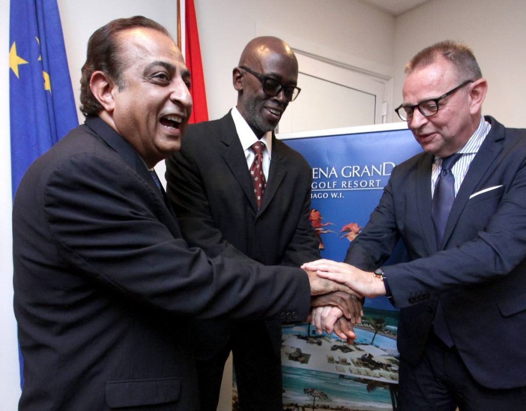 UNITED: General Manager of the Magdalena Grand Beach Resort Vinod Bajaj, left, DGEVENTS president Don Grant and Netherlands Ambassador to TT Jules Bijl, right, in a show of unity yesterday at the media Launch of Tobago Fashion Coda 6 'Smile' at the Embassy in the Trinre Building, Port of Spain.