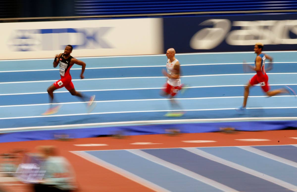 TT's Deon Lendore, left, participates in the men's 400m heats at the World Athletics Indoor Championships in Birmingham, Britain, yesterday. Lendore will run in today's final. AP Photo