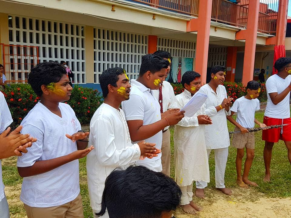 Vishnu Boys College students sing chowtaals at Phagwa celebrations at the school in Caroni on Friday.