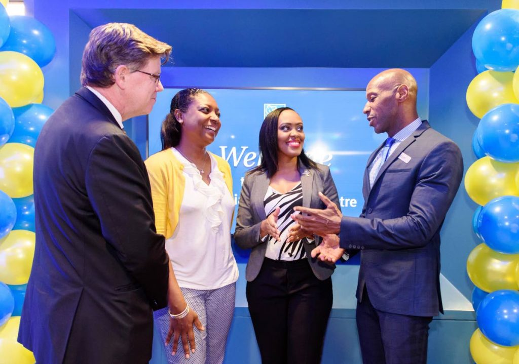 Managing Director RBC Royal Bank Trinidad and Tobago Darryl White (right) chats with RBC team members Technology Support Officer Marlene Joseph (second from right), and Retail Banking Associate Jolanda Phillip (second from left), while Head – Caribbean Banking, RBC Rob Johnston (left) looks on during the launch of the RBC Royal Bank Financial Solutions Centre in Point Lisas last month. Joseph and Phillip were winners of an internal bank competition.