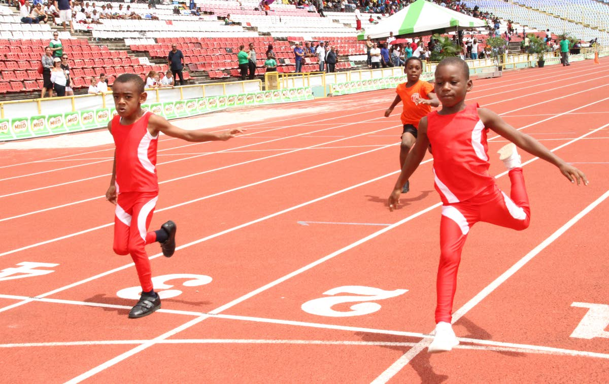 Hasheen Salandy,right, of tDiamond Vale Government Primary School finishes in first place ahead of schoolmate Ajani SPEEDSTER: Taylor,left, in the Boys U-7 50 metres race at the 31st MILO Games at the Hasely Crawford Stadium, Mucurapo yesterday.