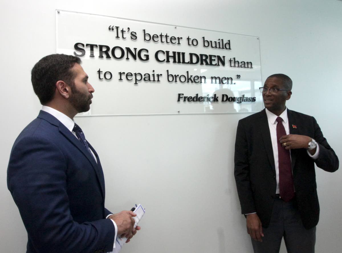 MEN OF LAW: Attorney General Faris Al-Rawi speaks with Chief Justice Ivor Archie at the opening of the Children Court at Elizabeth Street, St Clair yesterday.  PHOTO BY ROGER JACOB