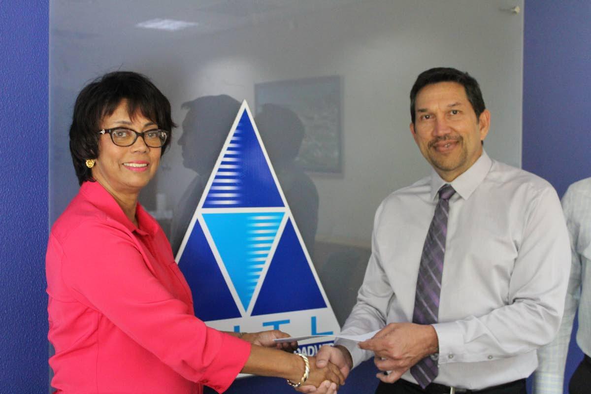 Methanol Holdings (Trinidad) Ltd CEO Dennis Patrick presents a cheque for $125,000 to Sheriba Ali-Rajack, the treasurer of the TT Music Festival Association. PHOTO BY CARLA BRIDGLAL