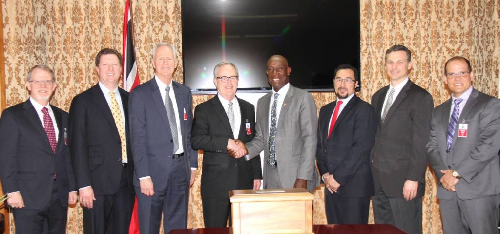 EOG Visit with PM Dr Keith Rowley: (Fifth from left) Prime Minister Dr Keith Rowley greets (fourth from left) Chairman and CEO of EOG Resources (EOG) William Thomas during the March 7 visit of a high-level EOG delegation to the Office of the PM (OPM), St Clair. Also pictured (left to right) are Vice President and General Manager, International, Pat Woods; Chief Operating Officer, Lloyd Helms; President, Executive Operations, Gary Thomas; Minister in the OPM and in the Ministry of the Attorney General and Legal Affairs, Stuart Young; Executive Vice President, Exploration & Production, David Trice and Managing Director, EOG Resources Trinidad Limited, George Vieira. PHOTO COURTESY OPM.
