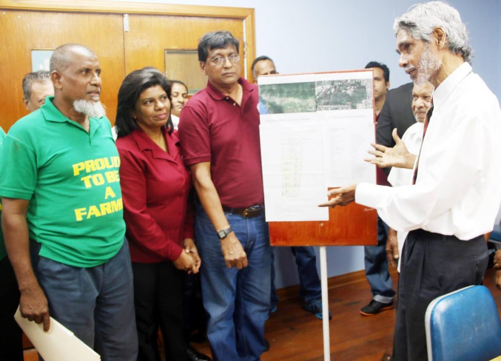 NO TO HOUSING: Environmental activist Wayne Kublalsingh, right, meets with Shiraz Khan, left, Dhano Sookoo, of the Agricultural Society, 2nd from left, and Evan Ramkhalawan yesterday at the OWTU headquarters in  San Fernando.