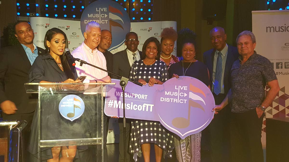 Principals at the Live Music District (LMD) launch from left, Quesi Des Vignes, THA councillor; Jeanelle Frontin, general manager,  MusicTT; Joel Martinez,   Mayor of Port of Spain; Calvin Bijou, chairman CreativeTT; Major Gen Edmund Dillon, Minister of National Security; Sena Paula Gopee-Scoon,  Minister of Trade and Industry, Dr Nyan Gadsby-Dolly, Minister of Community Development,Culture and the Arts; Sen Allyson West,  Minister in the Finance Ministry;  Robert Lee Hunte, Minister of Public Utilities; and Colm Imbert, Minister of Finance.