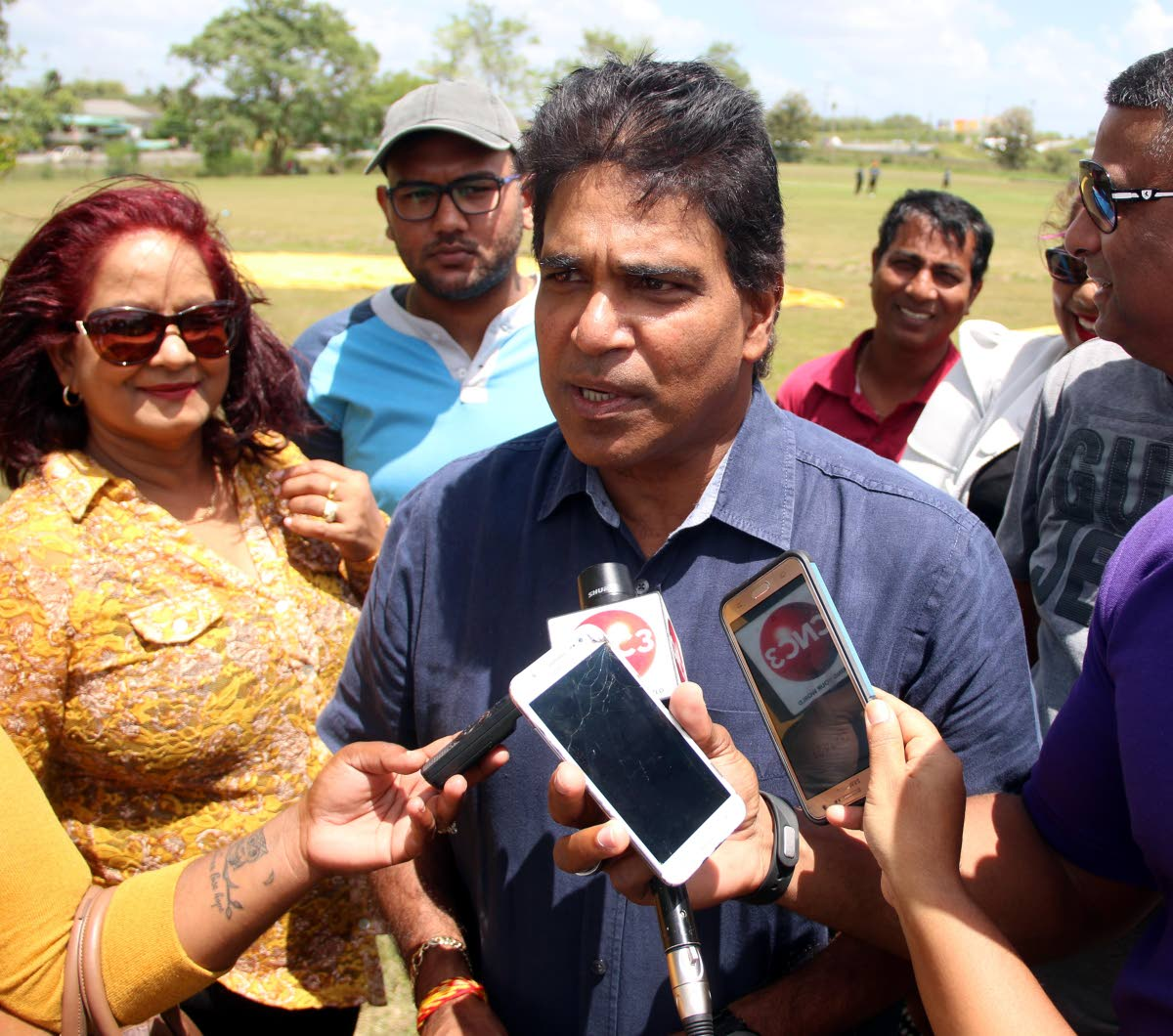 LAST TIME: Oropouche East MP Dr Roodal Moonilal speaks with  reporters at the UTT, Tarouba ground on Sunday.