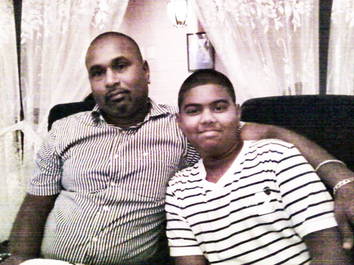 ME AND MY SON: Shakar Beephan is seen in this photo with his son Jesse who almost a year ago, was found murdered at the back of the Waterloo High School. To date, his killer remains at large.