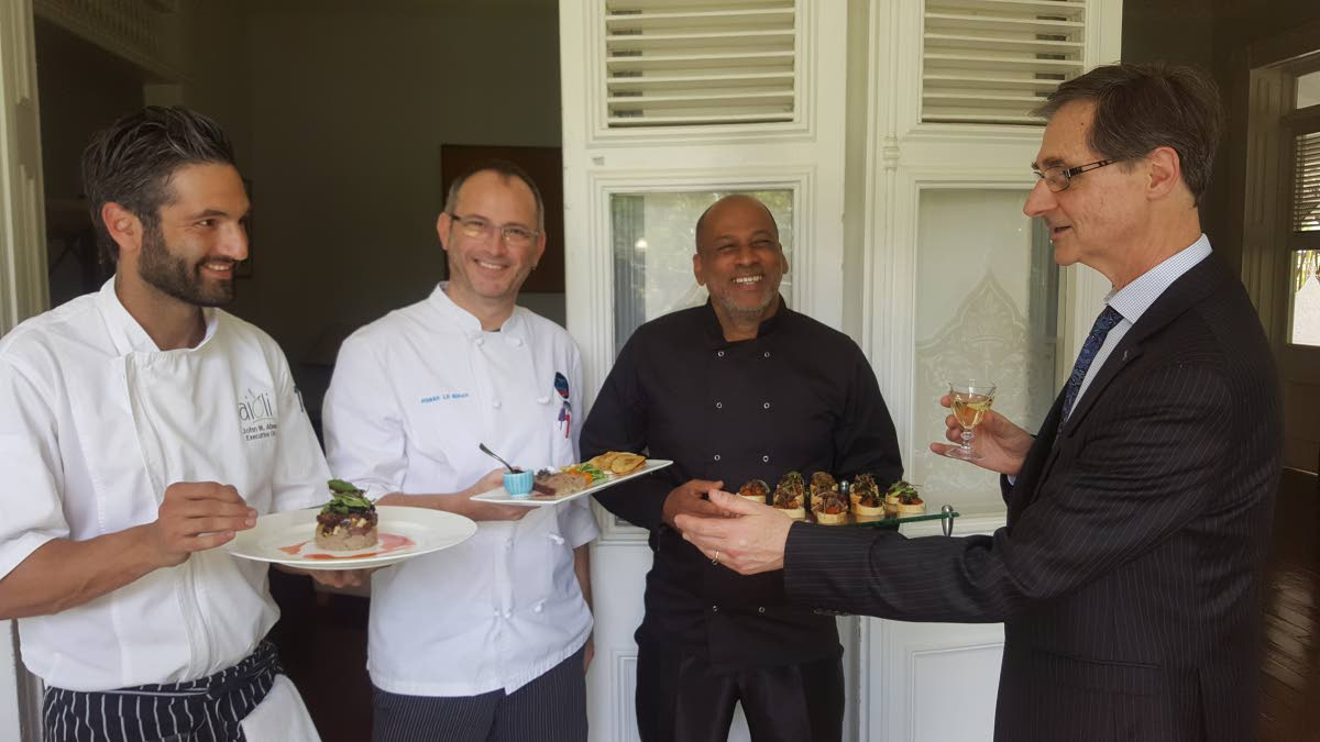 French Ambassador Serge Lavroff at right, gets samples of dishes from participating Chefs John Aboud (Aioli) from left, Pierre Le Bihan (AzAou) and Moses Ruben (Mélange)