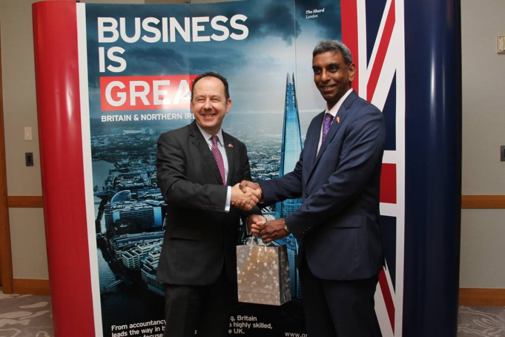 British High Commissioner Tim Stew (left) presents a gift to Sterling Chadee, Deputy Permanent Secretary in the Ministry of Health, at the recent UK Healthcare Market Visit at the Hyatt Regency Port of Spain. Photo by Rattan Jadoo