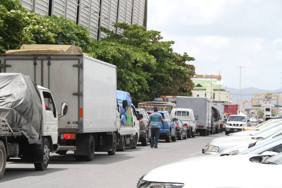 Trucks line up on Dock Road Port of Spain waiting to board the Cabo Star for Tobago. 15-03-18 PHOTO SUREASH CHOLAI