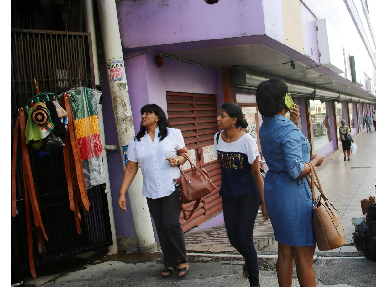Taking no chances: Pedestrians walk along High Street, San Fernando. Women say they are more alert after robberies in the southern city. PHOTO BY VASHTI SINGH