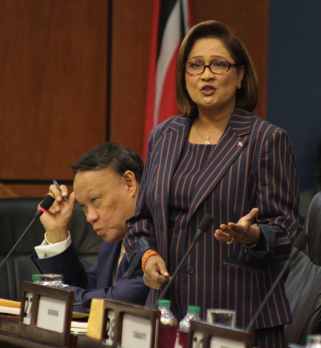 Kamla objects: Opposition Leader Kamla Persad-Bissessar asks why citizens can no longer do their own land search under the Registration of Titles to Land (Amendment) (No.2)  during debate in the Lower House on Friday. PHOTO BY ROGER JACOB