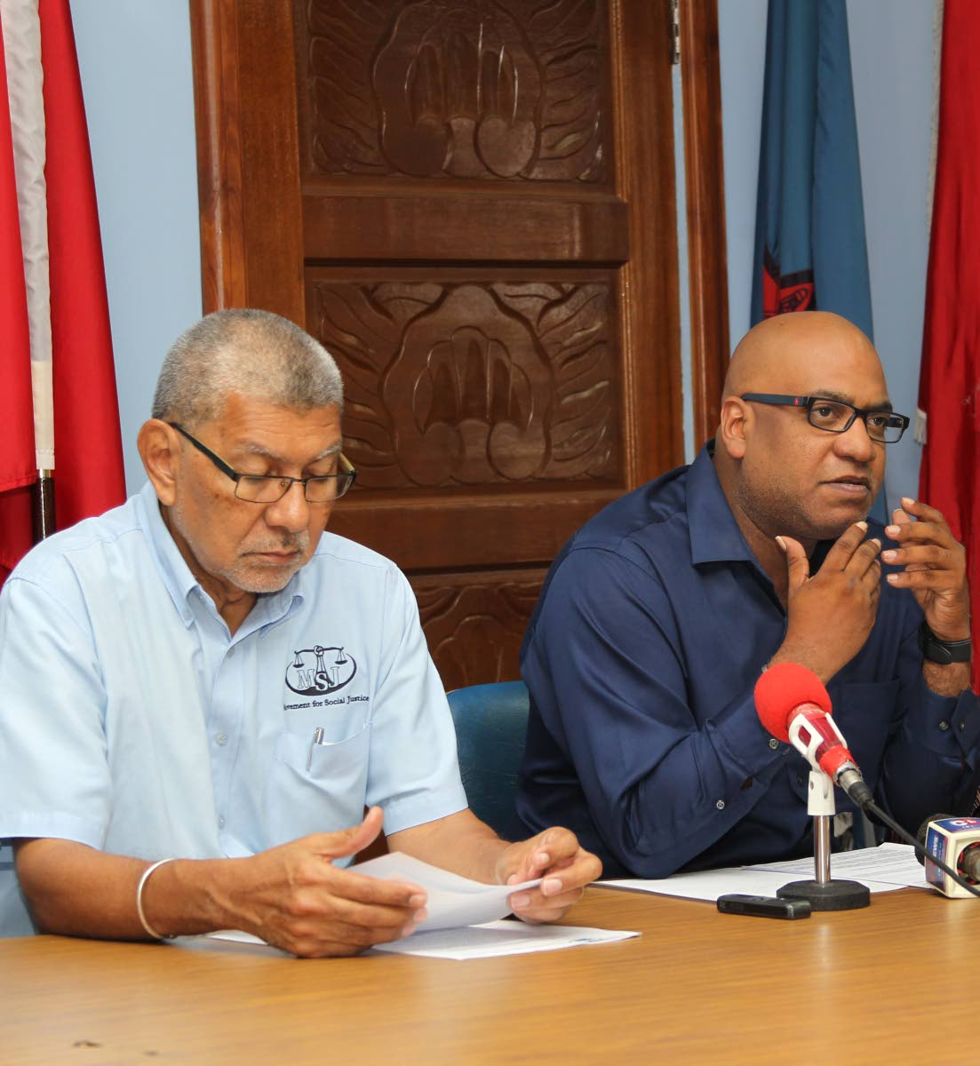 MATTERS AT HAND: MSJ political leader David Abdulah, left, listens as OWTU's Education and Research Officer Ozzi Warwick  PHOTO BY LINCOLN HOLDER