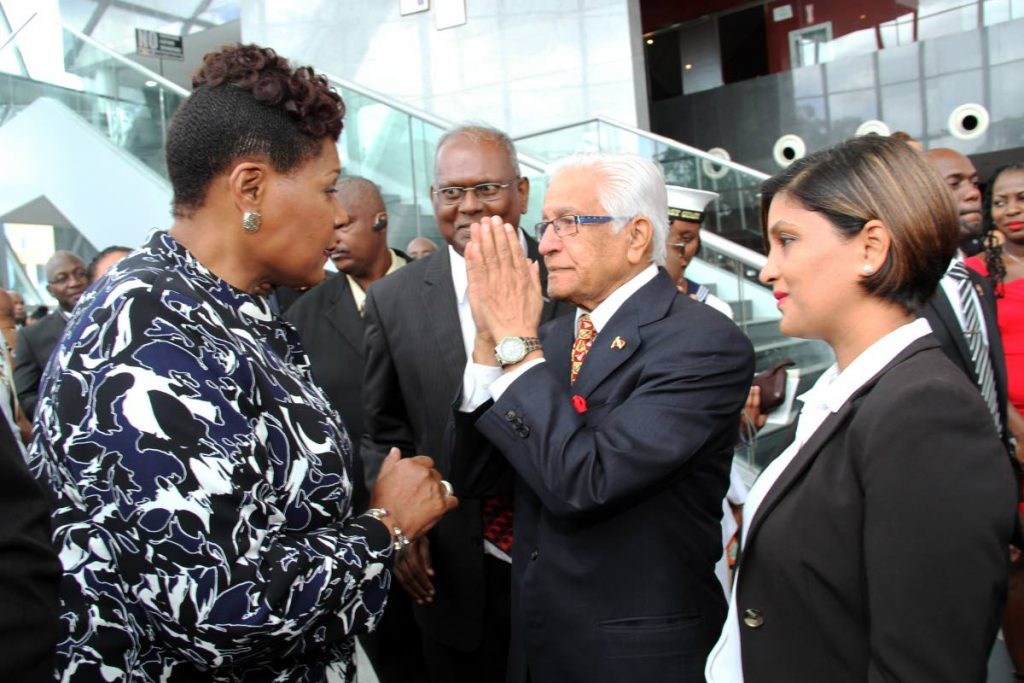 NAMASTE: Former prime minister Basdeo Panday, centre, greets new President Paula-Mae Weekes yesterday at a reception in her honour at NAPA in Port of Spain. At right is Panday's daughter Mickela. PHOTO BY SUREASH CHOLAI