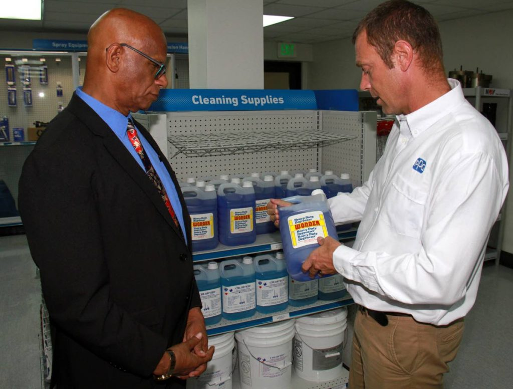 San Fernando Mayor Junia Regrello is shown a product by Industrial Marine Services general manager Christian Uhre during the opening of the store at Lady Hailes Avenue in San Fernando on Monday.