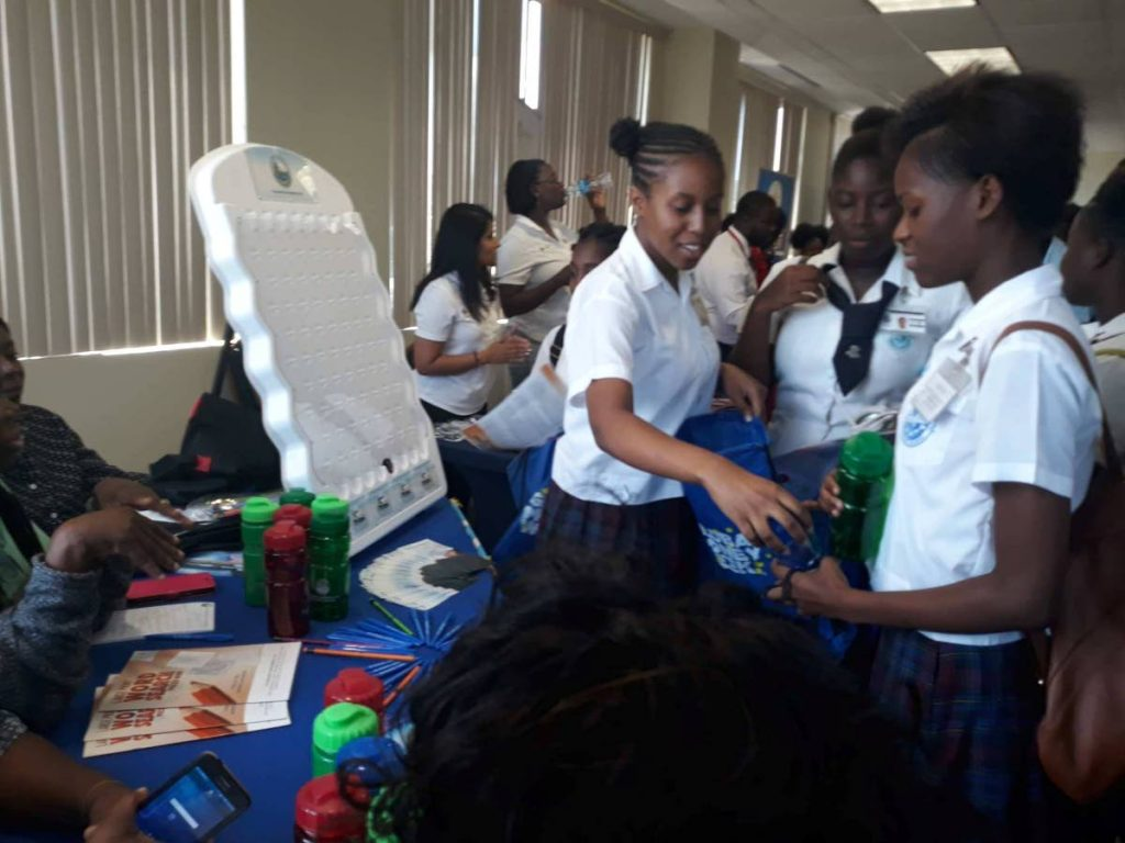 Secondary school students participate in the Global Money Week youth exposition at the Victor E Bruce Financial Complex last Tuesday hosted by the Division of Finance and the Economy.