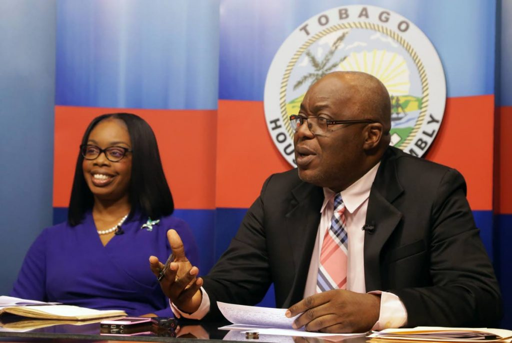 Chief Secretary Kelvin Charles, with Tourism Secretary Nadine Stewart-Phillips, speaks at Wednesday's post Executive Council media briefing at the Administrative Complex in Calder Hall.