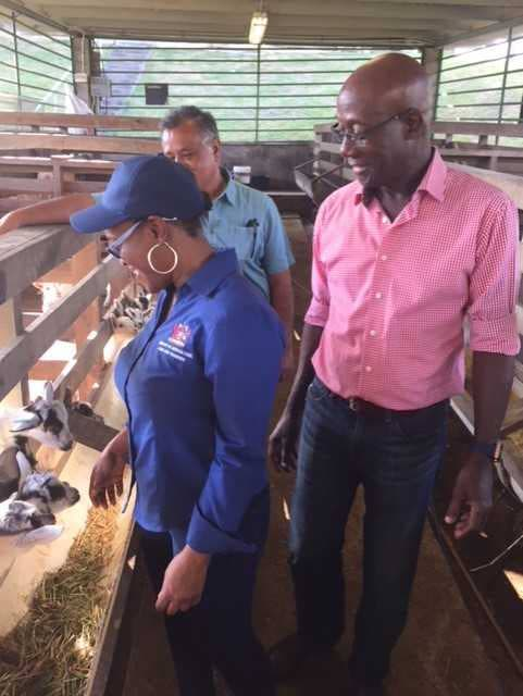 ON TOUR: Prime Minister Dr Keith Rowley looks on as Acting Chief Technical Officer in the Ministry of Agriculture Dr Simone Titus, interacts with kids during their tour of the Marillisa Farm in Penal on Monday. PHOTO COURTESY  MINISTRY OF AGRIFULTURE, LAND AND FISHERIES
