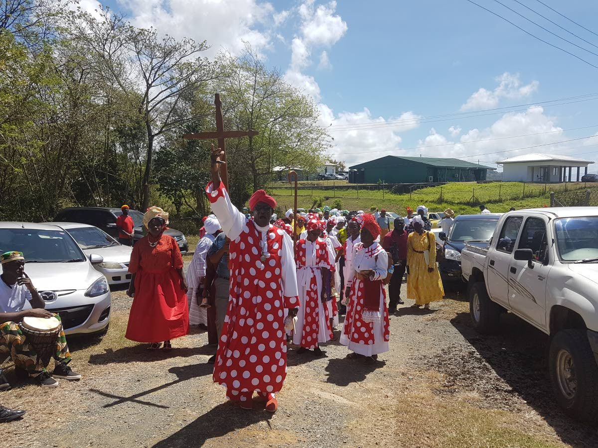 Bishop Mural Dillon, President of the Tobago United Spiritual Baptist Assembly, leads the procession of members along the Claude Noel Highway to the venue for the celebrations at the Assembly's land at Signal Hill last year.