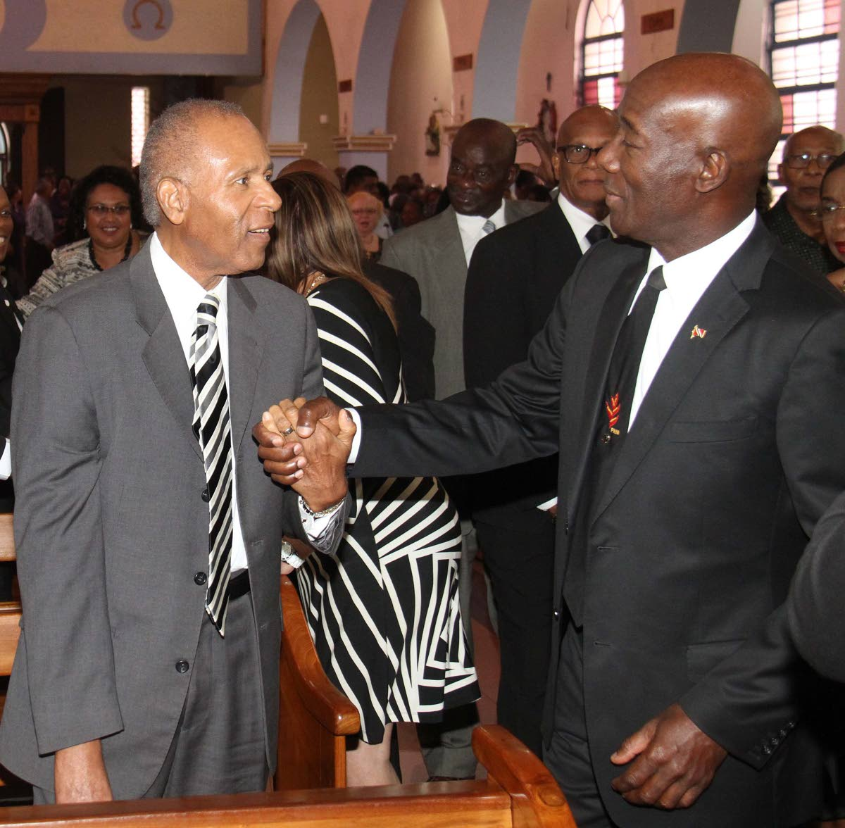 MY BROTHER: Prime Minister Dr Keith Rowley, right, warmly greets former prime minister Patrick Manning in February 2016, as they attended the funeral of PNMite Winston Moore. Five months later, Manning would die after at San Fernando General Hospital. FILE PHOTO