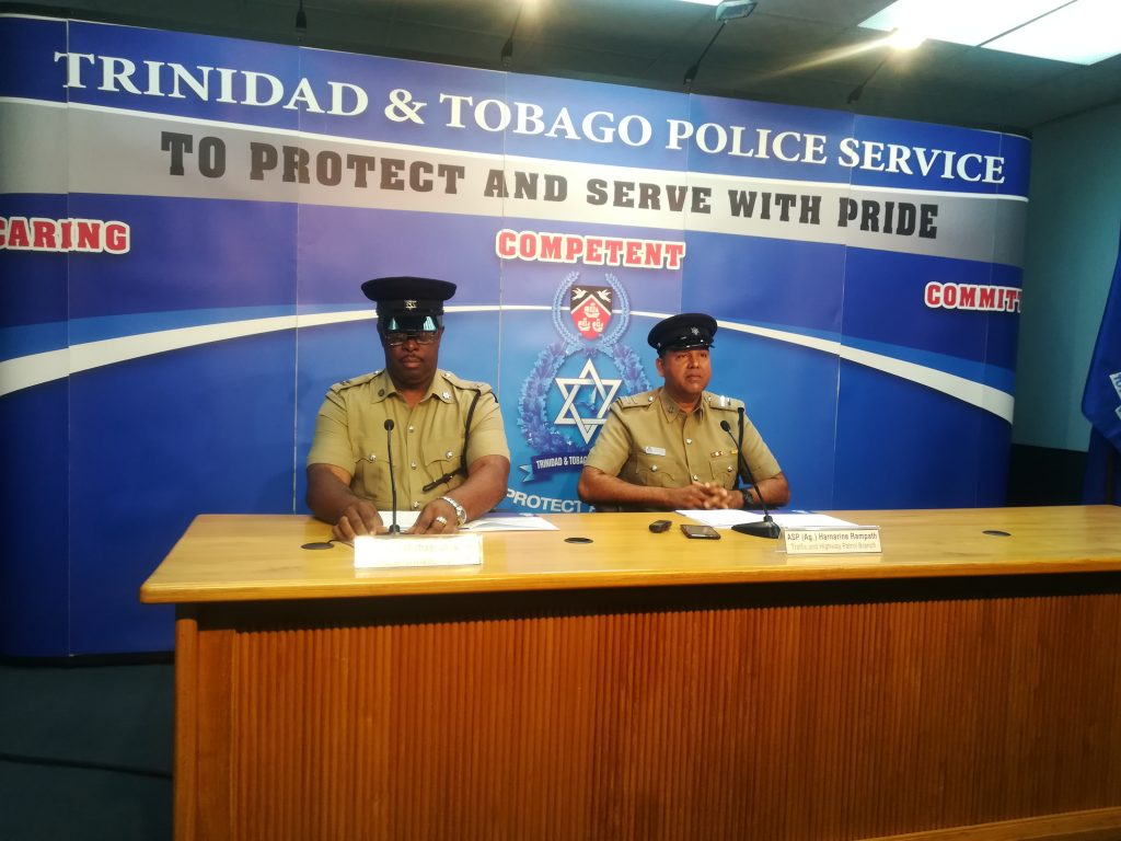 TTPS Public Information Officer Michael Jackman and ASP (Ag) Harrinarine Rampath of the Traffic and Highway Patrol Branch, address media at the TTPS weekly press briefing.