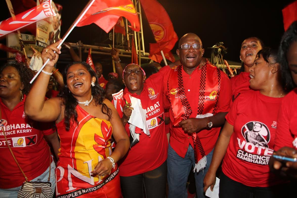 """Winston """"Gypsy"""" Peters in a celebratory mood with PNM supporters in a Rio Claro meeting during the 2015 general election campaign."""
