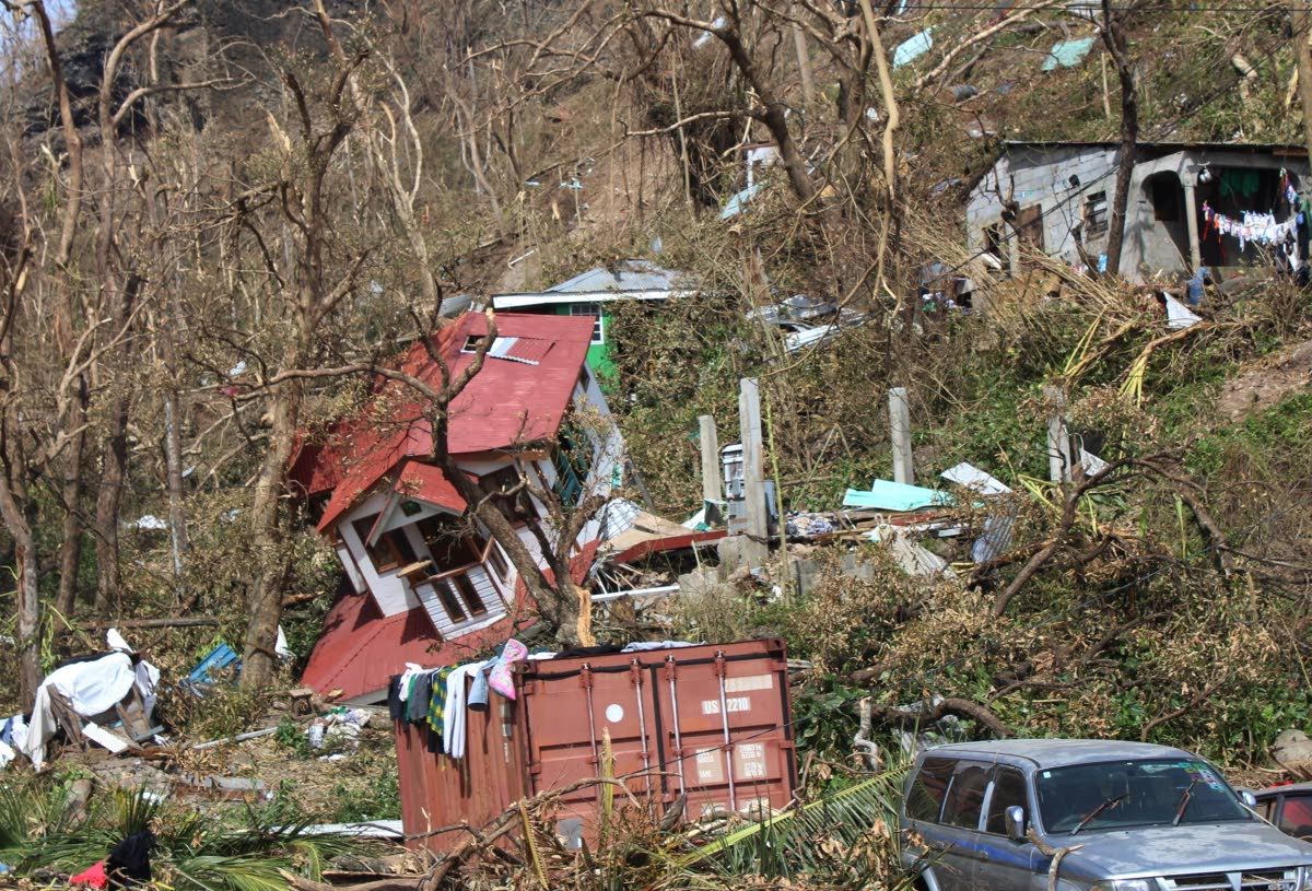 Homes are scattered after the passage of Hurricane Maria in Roseau, the capital of Dominica, on September 23, 2017. File photo