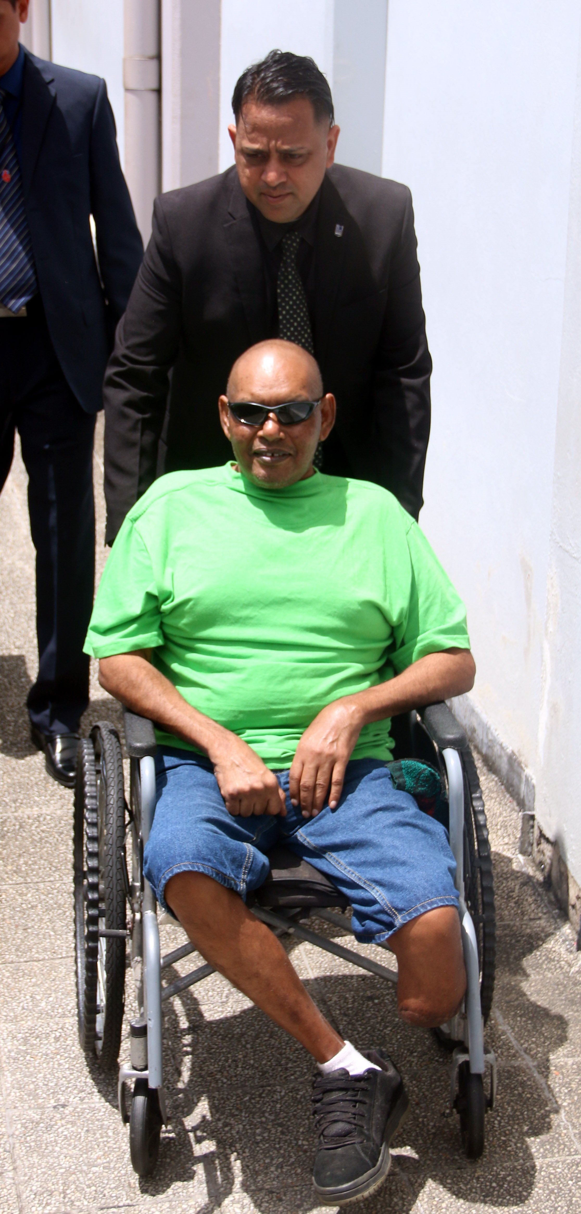 TESTIFIED: Amputee Arnold Lallbeharry, 53 is wheeled out of the San Fernando Magistrates Court yesterday. PHOTO BY ANSEL JEBODH