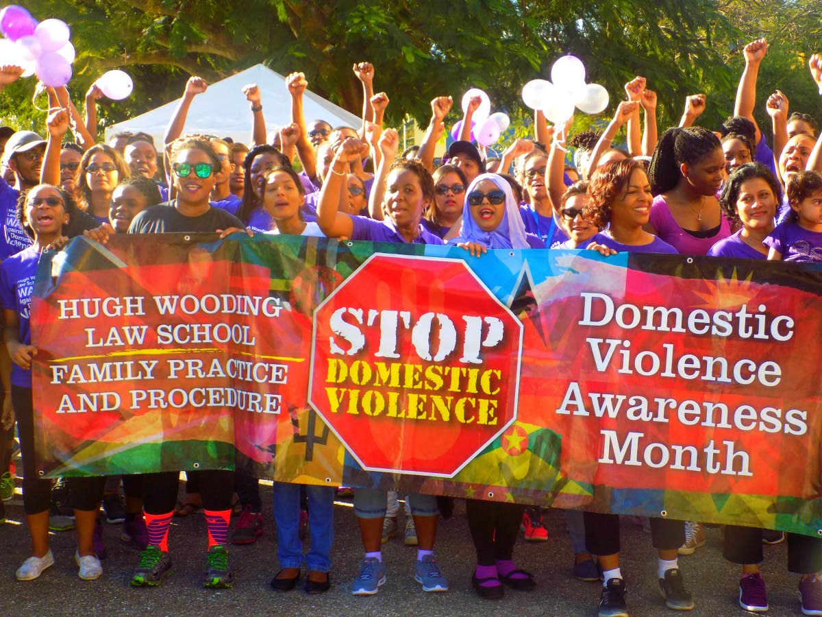 Staff and students of the Hugh Wooding Law School march against domestic violence at the campus grounds in St Augustine on March 2. Experts believe teaching boys and girls how to solve conflicts without violence is key to stopping the problem. FILE PHOTO