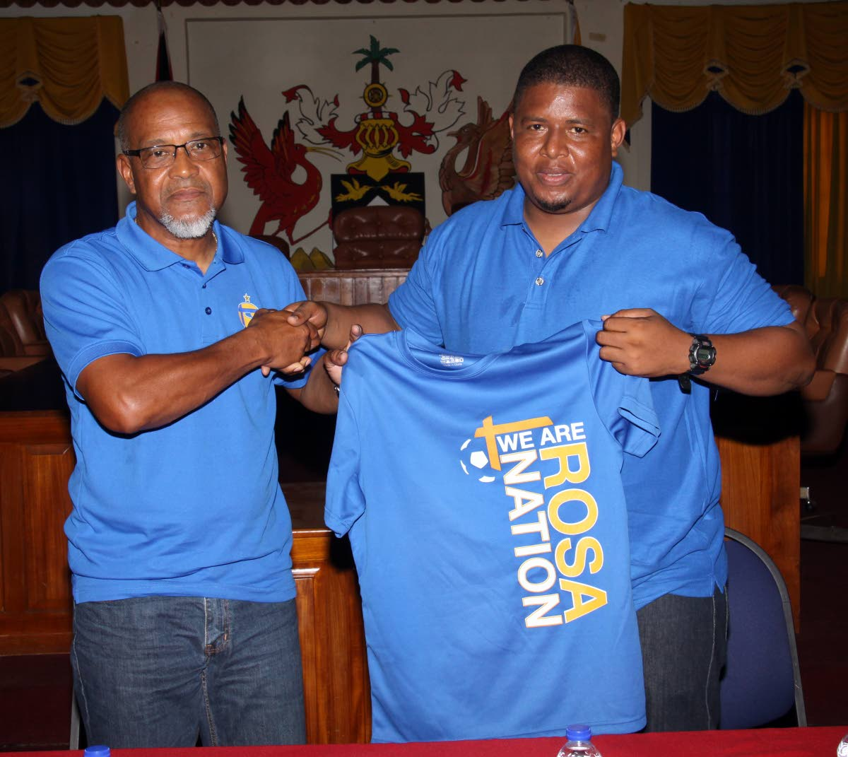 FC Santa Rosa president/owner/CEO Keith Look Loy (left) congraulates newly-appointed team coach Derek King during a media conference at the Arima Town Hall yesterday.