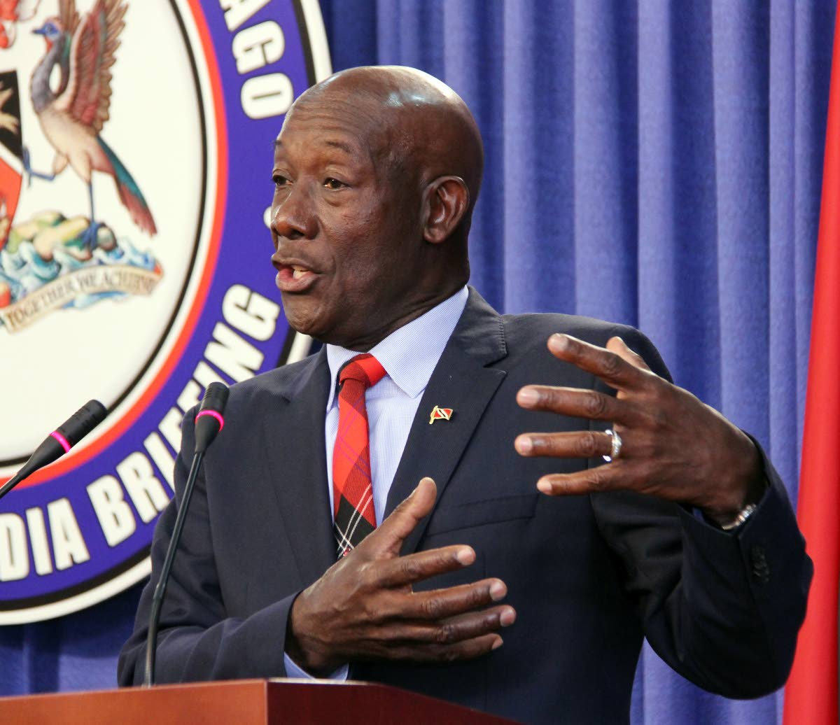EMBARRASSED: Prime Minister Dr Keith Rowley addresses the media at yesterday's post-Cabinet briefing at the Diplomatic Centre in St Ann's. PHOTO BY SUREASH CHOLAI