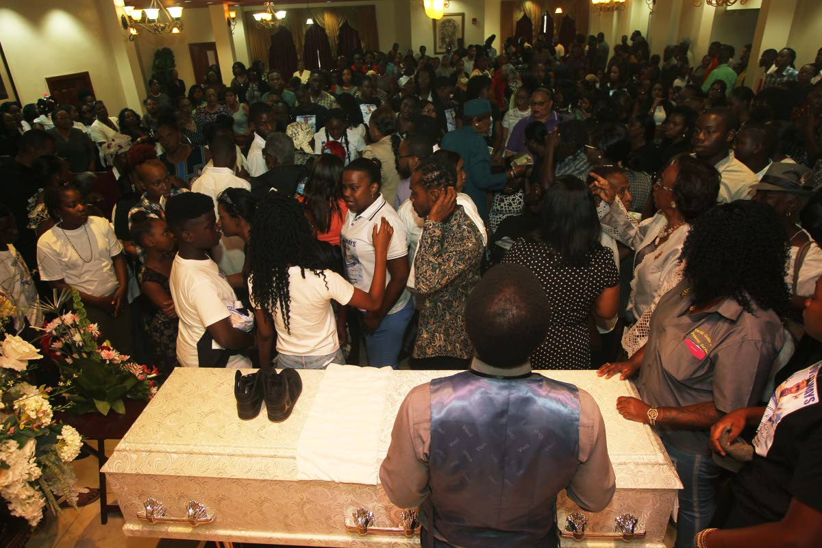 SEND OFF: Mourners packed the chapel of Guides Funeral Home and Crematorium in San Fernando yesterday for the funeral of murdered 19-year-old Rinarco Balgobin.