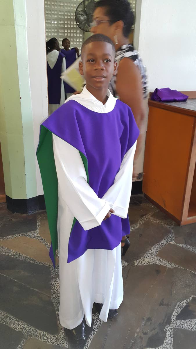 Osaze Badal is an altar server at St Francis of Assisi RC Church, Sangre Grande. He underwent life-saving heart surgery on March 28 during Holy Week.  PHOTOS COURTESY THE BADALS