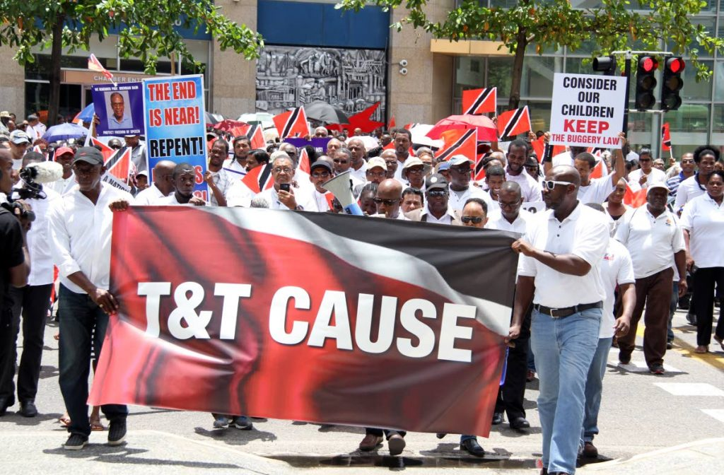 HEAR US: Members of Christian non-governmental organisation T&T Cause march outside the Parliament building calling for the law which criminalises the act of buggery to remain PHOTO BY SUREASH CHOLAI